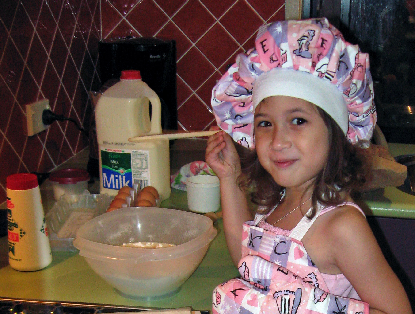 Young child cooking
